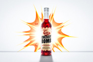 bottle of cherry bomb whiskey made by Eastside distilling in portland with real oregon cherries