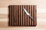 global chef knife on wooden cutting board
